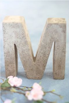 Concrete letter - You can buy a baking pan in the shape of any letter and then just coat it with cooking oil and fill with concrete. Let it set up and voilà you have a beautiful decoration for your home!