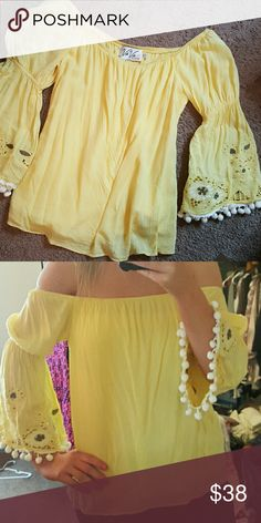 VaVa Off the Shoulder Top Worn Once/Excellent Condition  Size S  Soft yellow with white tassel balls Super cute with jeans or shorts! Vava by Joy Han Tops Blouses