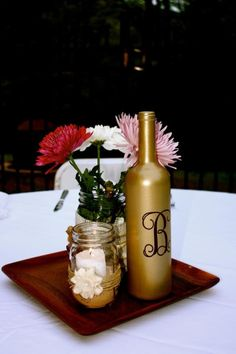 Burlap and mason jar centerpiece we designed for Bruce Wedding