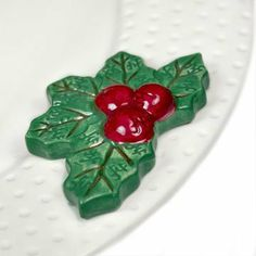 Nora Fleming - Holly and Berry Mini by Nora Fleming. $12.50. Low Shipping Costs!. Mix and match Nora Fleming minis and get 4 for $40!. All Minis sold by A. Dodson's are 4 for $40.. Change is good. Interchangeable is better! Imagine tableware that changes for every holiday, event or season. All you have to do is remove the Nora Fleming mini, add another and presto...a whole new look! All of Nora Fleming's minis are hand-painted with care and concern for every deta...