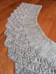 Ravelry: Oscilla Wrap pattern by Angela Hahn. A great worsted weight shawl pattern. #knitindie