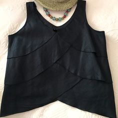 SALE  LIZ CLAIBORNE linen shell   NWT  100% linen scalloped tank, with peekaboo belly. Lovely!  wear on the job with a suit, then perfect with sexy jeans for cocktails and clubbin'. Fully lined (cotton), NWT, never worn, ready to go! Back is identical to front.  Make an offer!  Liz Claiborne Tops Camisoles