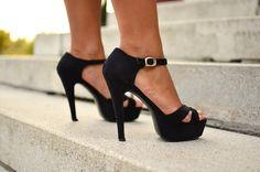Ankle strap platform sandals.