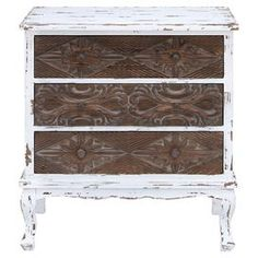 "Pairing weathered charm with artistic front paneling, this 3-drawer wood chest brings antiqued appeal to your entryway or living room.  Product: CabinetConstruction Material: WoodColor: White and brownFeatures: Three drawersDimensions: 30"" H x 16"" W"