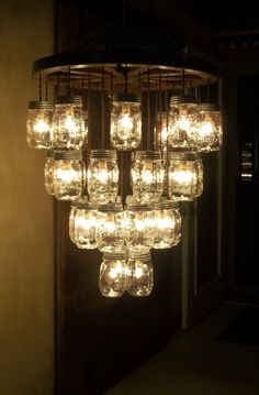 "I would love to be able to make something like this...WOODEN WAGON WHEEL 22"" Light Fixture-33 Mason Jar 4 Tier Chandelier Wood Wheel #WAGONWHEELCOUNTRYWESTERNPRIMITIVE"