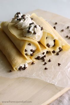 Cannoli Crepes -- soft crepes, filled with creamy, sweet ricotta and whipped cream and topped with chocolate chips. For breakfast, brunch or dessert! www.thereciperebel.com