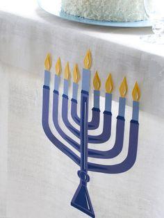 Festive Paper Menorah Tablecloth - Celebrating Hanukkah: Easy and Stylish Jewish Holiday Ideas on HGTV