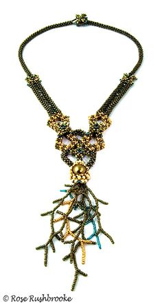 Chrysogonum, gold and green necklace - cubic right angle weave bead stitch. Made with seed beads, crystals, and glass pearls. Image copyright © Rose Rushbrooke.