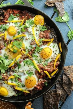 DELICIOUS all in one brunch dish with layers of rice, beans, salsa, crunchy chips and baked eggs. These baked huevos rancheros can feed a crowd.