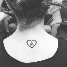 Tattoo Linkin Park : Heart shaped LP logo. Below neck, between shoulder blades. lp