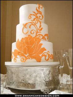 Orange and white patterened wedding cake by Bakery North Carolina Raleigh Cary Durham Triangle.  #Flowers #Floral. @Celebstylewed