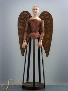 """28"""" Santos Cage Doll Angel w/ Removable Wings, Sienna  12345,  This is our popular Santos Cage Doll Angel. She's a gorgeous redhead, beautifully painted in shades brown with raw sienna peeking through the distressed paint. She has removable angel wings. Her wings are gold metal, with a brown, painted wax finish. She's a folk art doll with folksy features. She is intentionally distressed, and may display natural separation marks and light chippiness..."""