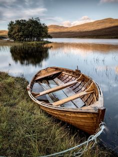 Moored On Loch Awe is a photograph by Dave Bowman. A moored, wooden rowing boat on the banks of Loch Awe, Assynt, Scotland. Source fineartamerica.com