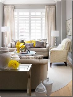 yellow and grey; I love the concept of neutral walls and pops of color. I would change the curtains to a pop of yellow.