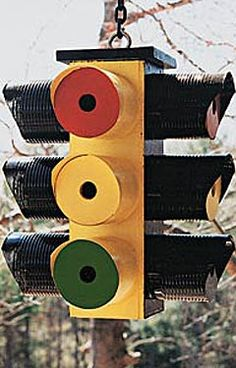 DIY Upcycled Traffic Light Birdhouse fromTtin Cans and Wood Post (Inspiration Only. No Pattern or Instructions.)
