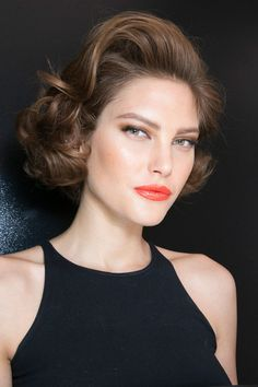 Holiday makeup featuring coral lips and a chic faux bob