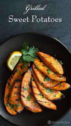 Grilled sweet potatoes! Slices of sweet potatoes grilled and slathered with a cilantro-lime dressing. Best way to eat sweet potatoes on a hot summer day! on /simplyrecipes/