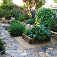 from houzz, like the coloured flagstone, adds depth to the yard