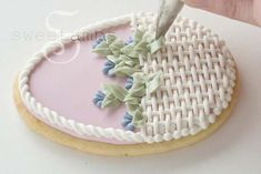 How to make pretty Easter basket cookies (Sweetambs). Great because you don't need a basket cookie cutter--just an oval (or egg) shaped cutter!