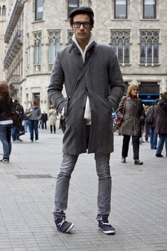 relaxed shoes gray skinny jeans fantastic clean lines coat with fuzzy sweater shoulder bag glasses taxi hat