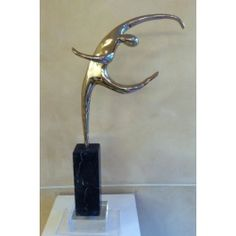 Alfred Tibor Sculpture Movement, Polished Bronze. Available at Argo & Lehne Jewelers.