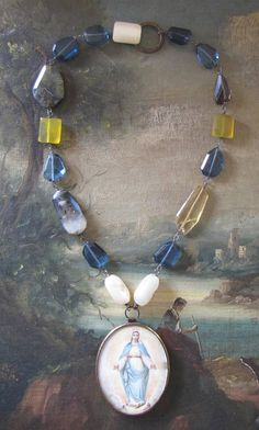 This necklace is absolutely beautiful and if you enjoy wearing religious jewelry, this is the piece for you!! The centerpiece came from a French Monastery and has been hand painted. Its a work of art! The chain Ive made for this necklace uses gorgeous antique mother of pearl beads