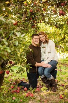 Engagement couple under apple tree in orchard - Tavia Larson Photography - Family, Children, and Engagement Photography - Hummelstown, PA