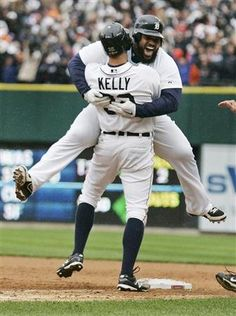 Detroit Tigers Prince Fielder jumps into the arms of teammate Kelly after Kelly hit a sacrifice flyball to score the winning run against the Oakland Athletics in the ninth inning of Game 2 in their MLB ALDS playoff baseball series in Detroit