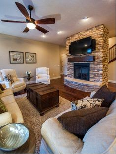 Fireplace ~ free-standing stone with natural wood mantle (but please relocate that television! ~ Heather)