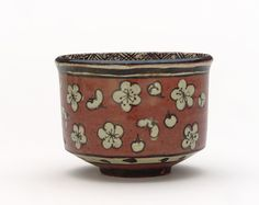 Kenzan-style tea bowl with design of plum blossoms | Ogata Kenzan (1643-1743) | Red earthenware with white slip and iron pigment under transparent lead glaze | Meiji era | late 19th century | Gift of Charles Lang Freer | Freer Gallery of Art and Arthur M. Sackler Gallery | F1900.74
