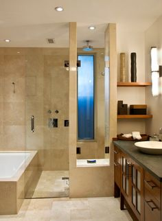 Storage cubby near sink dividing shower/sinks, continuous materials, connection between shower and tub