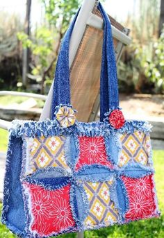 Recycled denim bag. Oh how I love this, would want the handles attached on the ends tho. This is too cute!