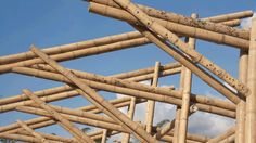 Bamboo construction made with and Guadua canes to create the roof structure from a truss formed by the union of two composite beams (double) with 9 and 12 m length Bamboo Roof, Bamboo Tree, Bamboo Building, Natural Building, Bamboo House Design, Wood Truss, Primitive Kitchen Decor, Jungle House, Bamboo Structure