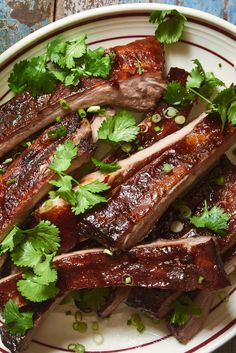 NYT Cooking: These are the best oven-roasted ribs ever, and they can also be finished on a grill for extra smoky flavor. Creating steam in the oven is the key to tender meat. The ingredients here are close to the ones used by traditional Cantonese barbecue masters to produce sticky-salty-sweet meat that has a reddish, caramelized crust — with ketchup standing in for Chinese red fermented tofu. (It can be le...