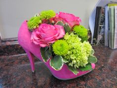 This pink high heel made a great centerpiece for the launch party of a business with a pink high heel logo!
