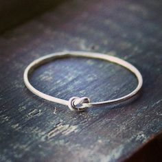 Tiny Knot Ring in Sterling Silver by indiaylaluna on Etsy, $24.00   ***to the bridesmaids for helping tie the knot***