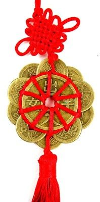 Feng Shui Coins are symbolic magnets to increase your financial chi. This tassel features twelve coins - a number to attract great prosperity - and a lucky red knot.