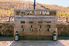 This couple made a custom DIY beer bar for their wedding with kegs behind the wall and taps labeled with their favorites: pilsner, saison, porter, and IPA.  photo: sweet little photographs   http://emmalinebride.com/uncategorized/diy-beer-bar-inspiration/