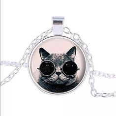 Cool cat necklace FREE W/$25+ FREE W/$25+ PURCHASE.                                ➖Cool cat necklace. The pendent is about the size of a quarter  Entropy Jewelry Necklaces