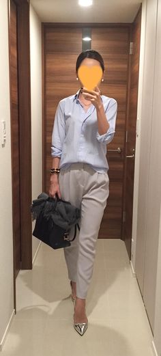 Blue shirt: Kamakura, Light grey pants: Des Pres, Bag: Tod's, Silver heels: PRADA
