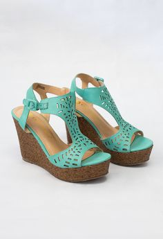 Pattern cut out wedge sandals with 4.5 inch heel.