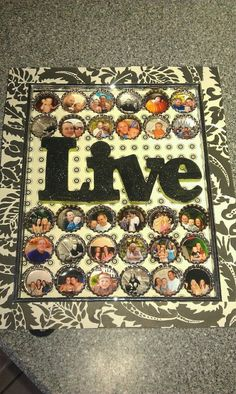 Bottle Cap Photo Frame:  Pick out your favorite scrapbook paper; glue it around the frame and use as the background; print and place your photos in the caps; add resin to seal photos if desired; add a word; glue it and position it all together.  Supplies can be found at Hobby Lobby.