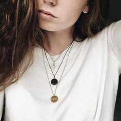Styling by stephaniehammelboe showing Bang Pendant Gold, Love Pendant Grey Rhodium, Diamond Cut Ball Chain Gold 60 cm , Anchor Chain Fine Grey Rhodium 45 cm, Delight Ear Jackets Seven Gold and Delight Zirconia Ear Studs Large Gold #jewellery #Jewelry #bangles #amulet #dogtag #medallion #choker #charms #Pendant #Earring #EarringBackPeace #EarJacket #EarSticks #Necklace #Earcuff #Bracelet #Minimal #minimalistic #ContemporaryJewellery #zirkonia #Gemstone #JewelleryStone #JewelleryDesign…