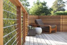Contemporary Deck with ST. BARTS LOUNGE CHAIR, ESTATE ZINC SQUARE COLLECTION, Ultra - tec cable railing systems