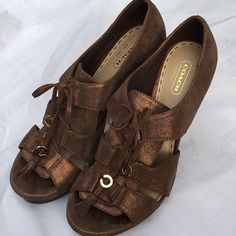 """AUTHENTIC COACH """"Teagan"""" heels I love these shoes!!  I'm even hesitant to sell them but if I don't they'll just sit in my closet and collect dust.  I'd rather someone else love them and use them. They're in really good condition. Heel measures 5"""" and platform is about 1/4"""". Color is like a metallic brown. Coach Shoes Platforms"""
