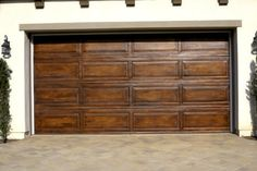 Love this idea! It's a standard, metal garage door painted with a faux wood-grain technique.