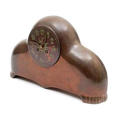 Patinated copper Amsterdam School mantel clock with dial with green painted numbers designer execution unknown the Netherlands ca.1925