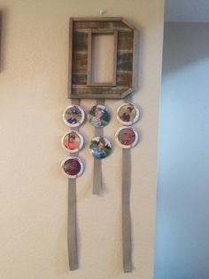 Sports Button holder I made today.  Finally I have a way to display all my boys sports buttons.