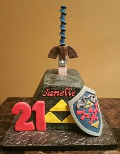 For that Zelda fan! Sword in a stone cake with shield.