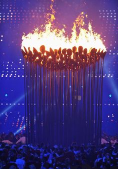 2012 olympics cauldron - the dandelion-like design, is composed from 204 petals (each representing a competing nation), which are attached to levered stems that pump natural gas to each petal. the stems gently rised from the ground upwards and converged to form one great flame of unity, representative of the transitory togetherness that is embodied in the olympic games - 2012 olympics cauldron designed by Thomas Heatherwick